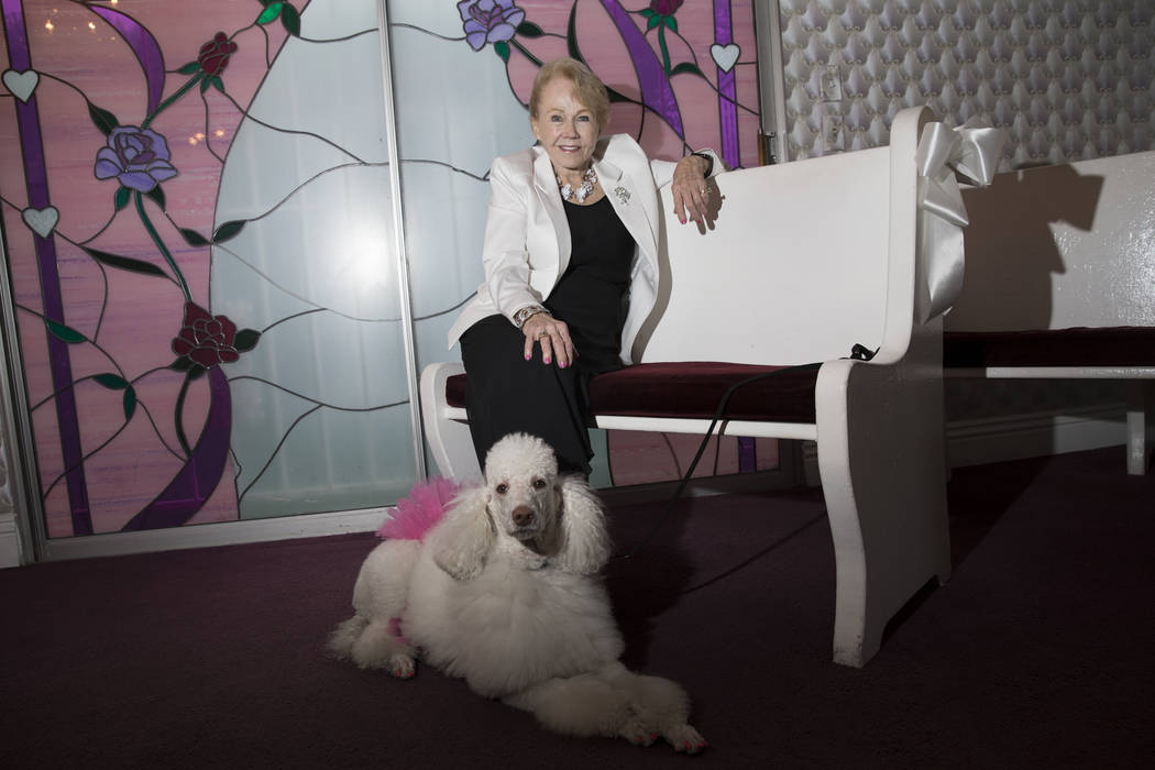 Charolette Richards, owner of A Little White Wedding, with her dog at her Las Vegas business, Wednesday, Jan. 24, 2018. Erik Verduzco Las Vegas Review-Journal @Erik_Verduzco