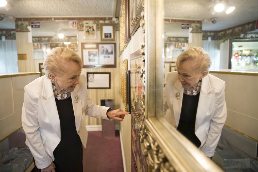 Charolette Richards, owner of A Little White Wedding shows articles about her business, at her Las Vegas business, Wednesday, Jan. 24, 2018. Erik Verduzco Las Vegas Review-Journal @Erik_Verduzco