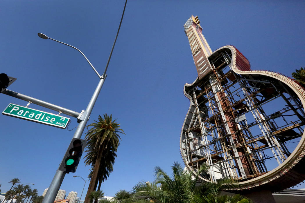 The Hard Rock Café neon sign at the corner of Harmon and Paradise is coming down and moving to a new home in the Neon Museum. Friday, September 1, 2017 Michael Quine Las Vegas Review-Journal @Veg ...