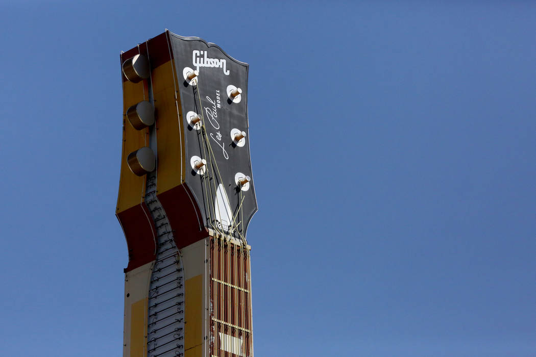 The Hard Rock Café neon sign with its distinctive Gibson Les Paul headstock at the corner of Harmon and Paradise is coming down and moving to a new home in the Neon Museum. Friday, September  ...