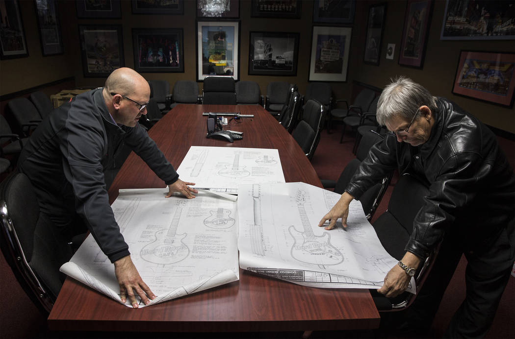 Rick Juleen, left, vice president of business development at Young Electric Sign Co. Las Vegas, and Ed Stagner, assistant sales manager, look over the original sketches of the recently removed neo ...