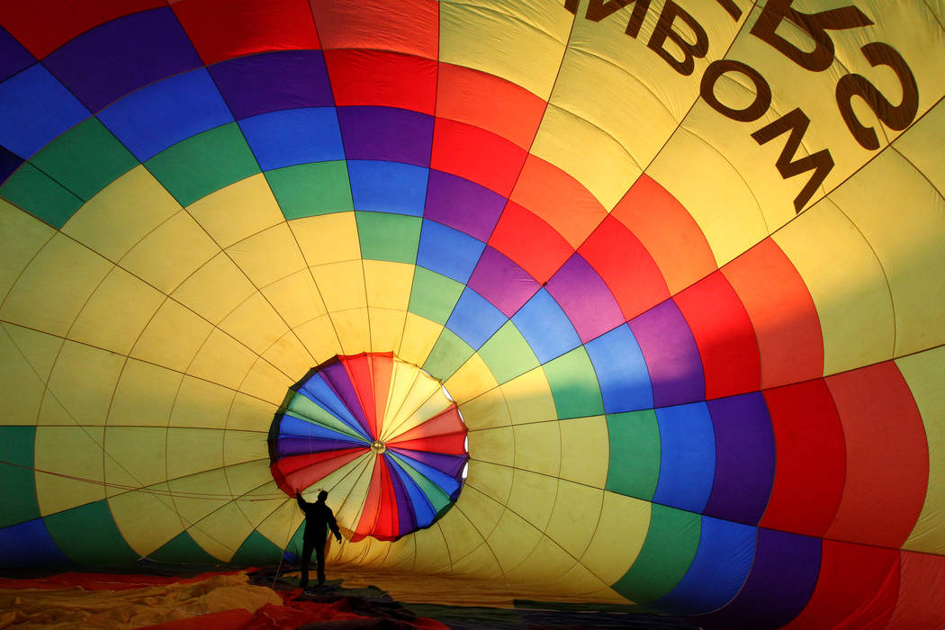 Daniel Liberti, a hot air balloon pilot with Rainbow Ryders, prepares for an early morning flight at an empty southwest Las Vegas lot Wednesday, Jan. 24, 2018. K.M. Cannon Las Vegas Review-Journal ...