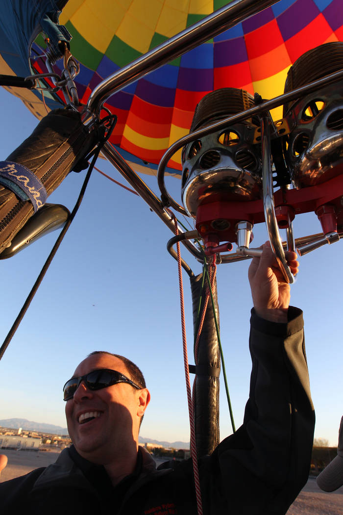 Daniel Liberti, a hot air balloon pilot with Rainbow Ryders, lifts off for an early morning flight from at an empty southwest Las Vegas lot Wednesday, Jan. 24, 2018. K.M. Cannon Las Vegas Review-J ...