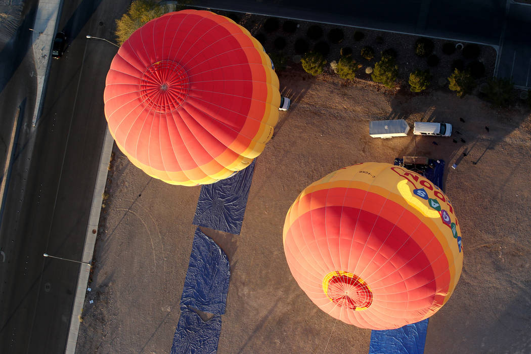 Balloons are seen from a hot air balloon piloted by Daniel Liberti of Rainbow Ryders during an early morning flight at an empty southwest Las Vegas lot Wednesday, Jan. 24, 2018. K.M. Cannon Las Ve ...