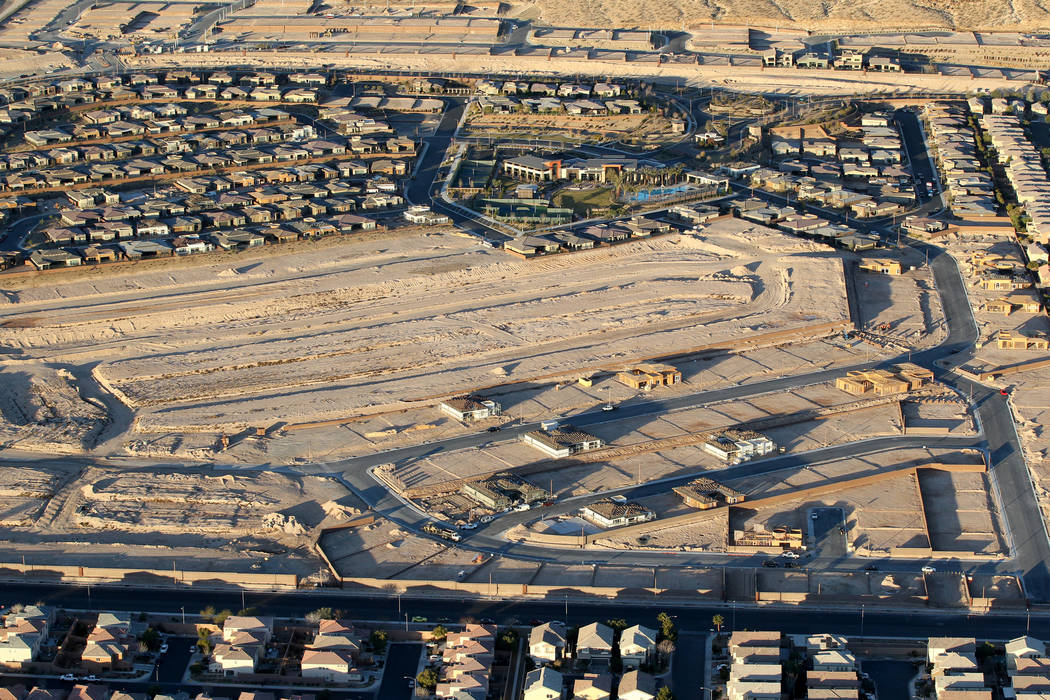 Southwest Las Vegas homes and a construction site are seen from a hot air balloon piloted by Daniel Liberti of Rainbow Ryders during an early morning flight Wednesday, Jan. 24, 2018. K.M. Cannon L ...