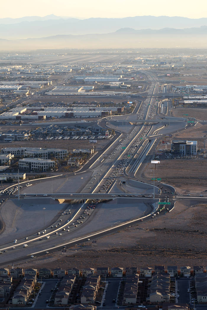 Commuters on the southern beltway as seen from a hot air balloon piloted by Daniel Liberti of Rainbow Ryders during an early morning flight in southwest Las Vegas Wednesday, Jan. 24, 2018. K.M. Ca ...