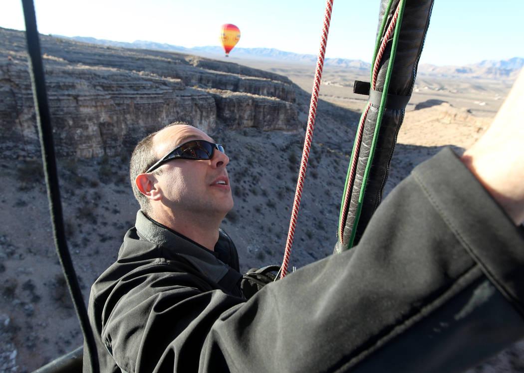 Daniel Liberti, a hot air balloon pilot with Rainbow Ryders, flies over southwest Las Vegas Wednesday, Jan. 24, 2018. K.M. Cannon Las Vegas Review-Journal @KMCannonPhoto
