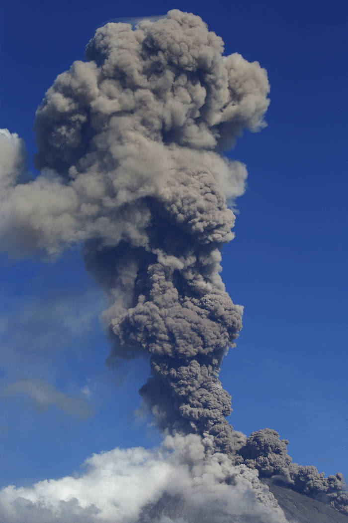 Mayon volcano spews ash as it erupts anew Tuesday, Jan. 23, 2018 as seen from Legazpi city, Albay province, around 340 kilometers (200 miles) southeast of Manila, Philippines. The Philippines' mos ...