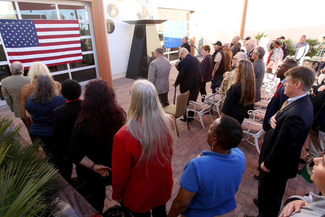 Veterans and supporters recite the Pledge of Allegiance at Veterans Village 2 in downtown Las Vegas Wednesday, Jan. 24, 2018, before a speech from Republican gubernatorial candidate Nevada Attorne ...