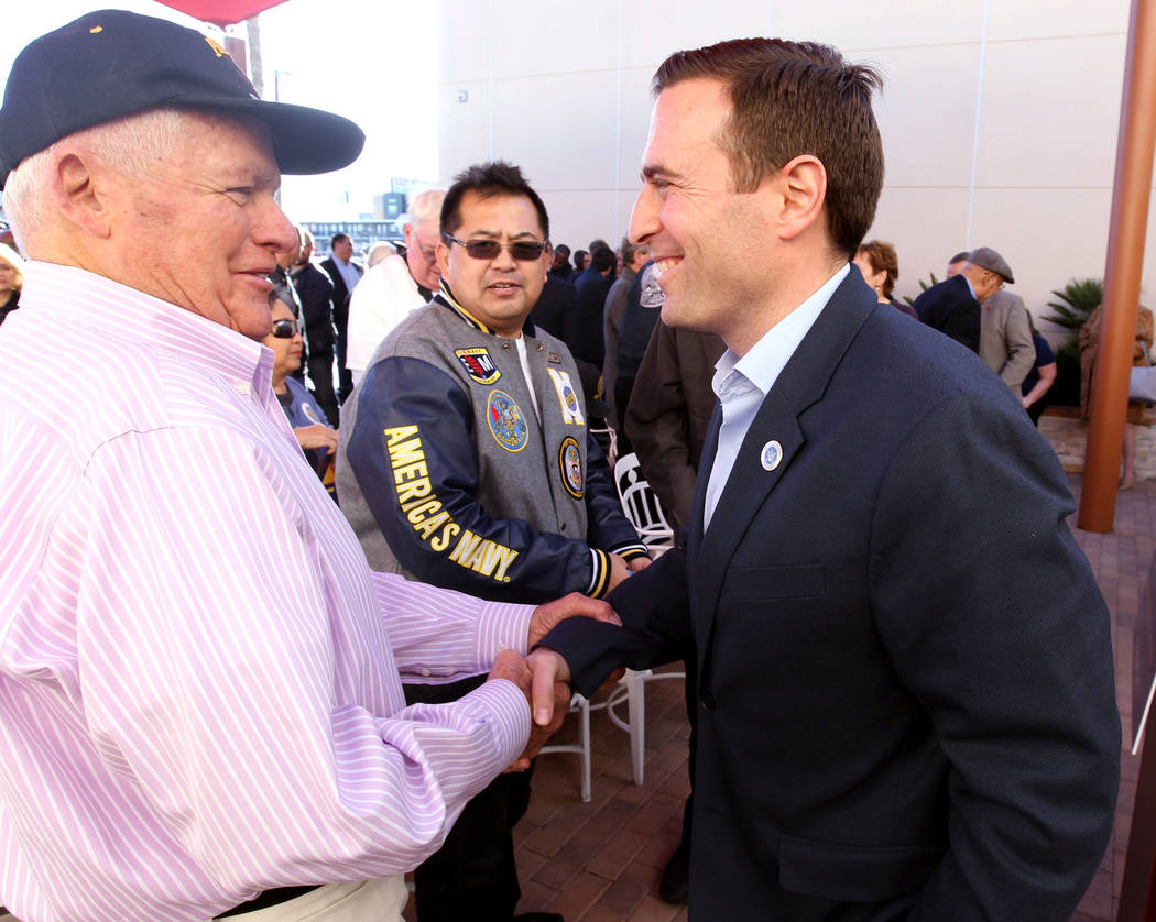 Republican gubernatorial candidate Nevada Attorney General Adam Laxalt, right, greets Frank Myers after speaking at Veterans Village in downtown Las Vegas Wednesday, Jan. 24, 2018. (K.M. Cannon/La ...