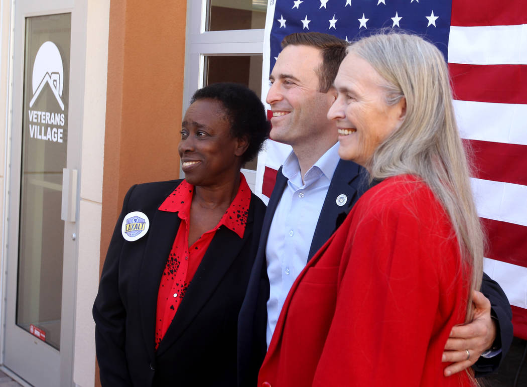 Republican gubernatorial candidate Nevada Attorney General Adam Laxalt, center, poses with Sandra Scott, left, and Dixie Thompson after speaking at Veterans Village in downtown Las Vegas Wednesday ...