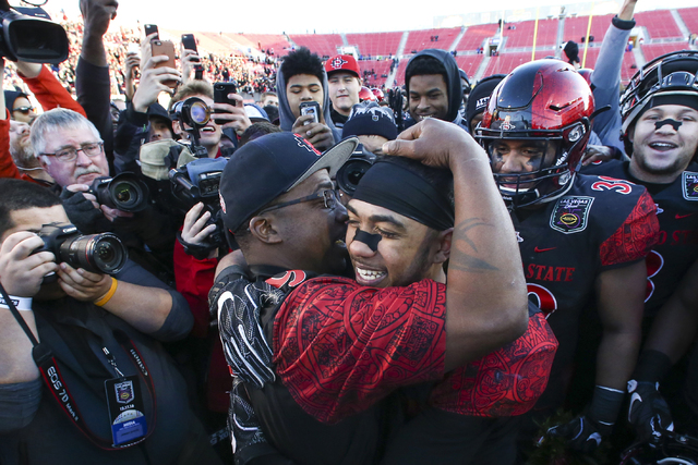 San Diego State running back Donnel Pumphrey (19) celebrates with his father, Donnel Humphrey Sr., after defeating Houston in the Las Vegas Bowl at Sam Boyd Stadium in Las Vegas on Saturday, Dec.  ...