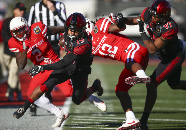 San Diego State running back Donnel Pumphrey (19) steps out of bounds while trying to evade Houston defense during the Las Vegas Bowl at Sam Boyd Stadium in Las Vegas on Saturday, Dec. 17, 2016. ( ...