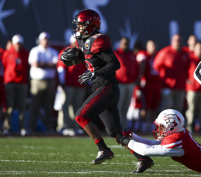 San Diego State running back Donnel Pumphrey (19) gets past Houston during the Las Vegas Bowl at Sam Boyd Stadium in Las Vegas on Saturday, Dec. 17, 2016. (Chase Stevens/Las Vegas Review-Journal)  ...