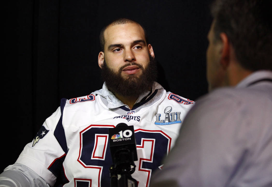 New England Patriots defensive end and Las Vegan Lawrence Guy listens to media questions during a media day at the Mall of America ahead of Super Bowl LII in Bloomington, Minn., Wednesday, Jan. 31 ...