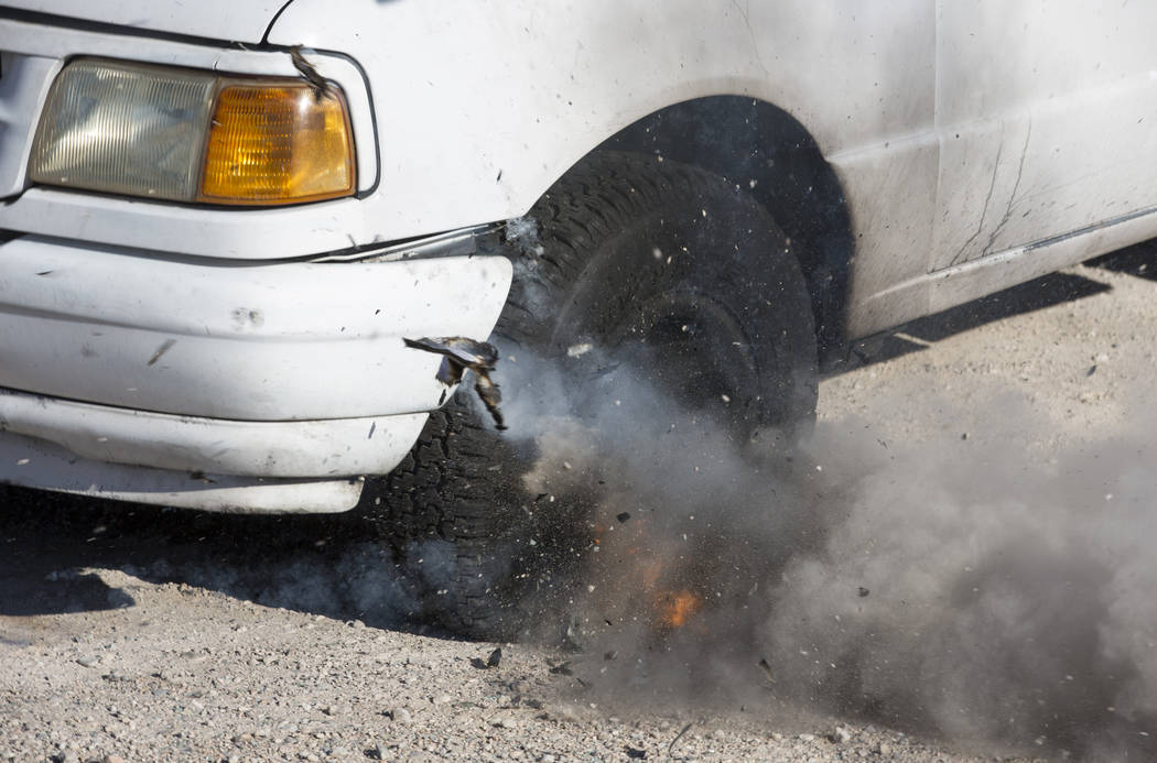 A tire on a truck explodes during a car arson demonstration and training seminar at the Clark County Fire Academy in Las Vegas, Friday, January 26, 2018. Richard Brian/Las Vegas Review-Journal @ve ...