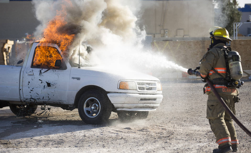 Firefighters extinguish a fire during a car arson demonstration and training seminar at the Clark County Fire Academy in Las Vegas, Friday, January 26, 2018. Richard Brian/Las Vegas Review-Journal ...