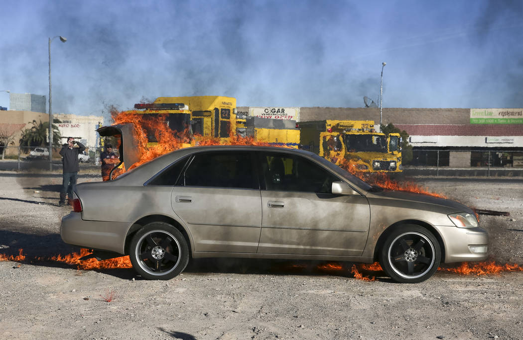 A car is set on fire during a car arson demonstration and training seminar at the Clark County Fire Academy in Las Vegas, Friday, January 26, 2018. Richard Brian/Las Vegas Review-Journal @vegaspho ...