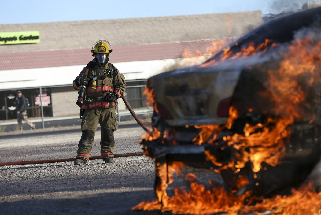 A firefighter keep watch during a car arson demonstration and training seminar at the Clark County Fire Academy in Las Vegas, Friday, January 26, 2018. Richard Brian/Las Vegas Review-Journal @vega ...