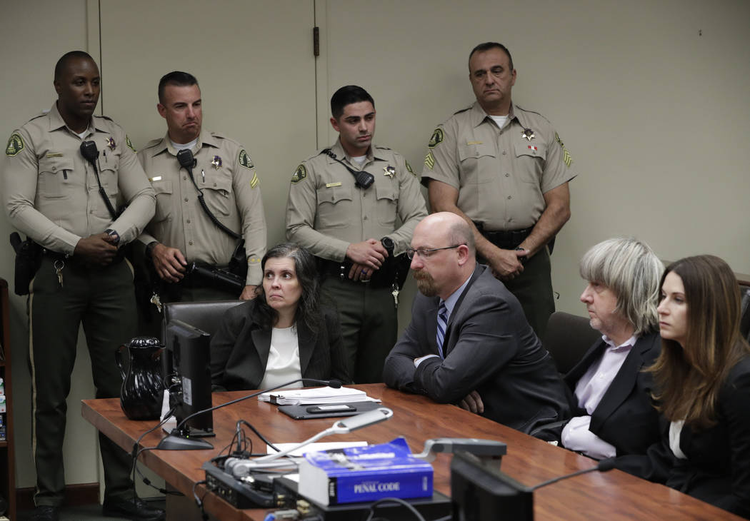 Defendants Louise Anna Turpin, left, with attorney Jeff Moore, and David Allen Turpin, right, with attorney Allison Lowe, appear in court for their arraignment in Riverside, Calif., Jan. 18, 2018. ...