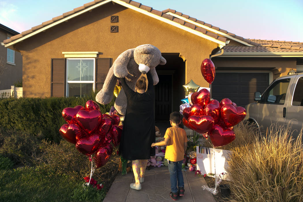 "Neighbor Liza Tozier, and her son, Avery Sanchez, 6, drop off his large ""Teddy"" as a gift for the children who lived on a home where police arrested a couple accused of holding 13 children captive ..."