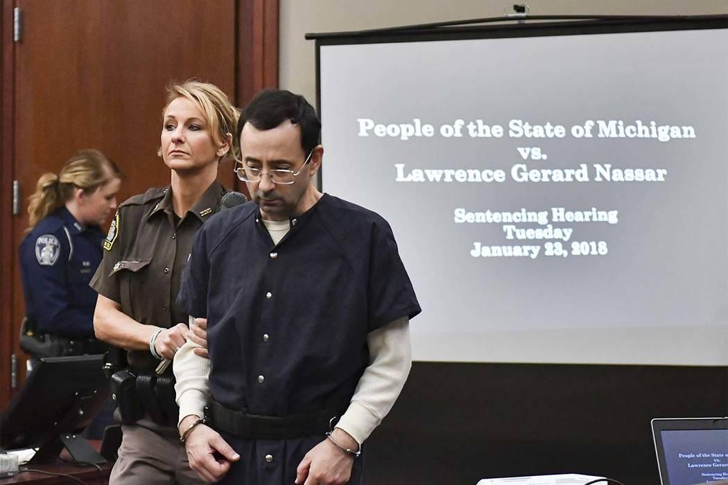 Larry Nassar is brought into court Tuesday, Jan. 23, 2018, in Lansing, Michigan.  (Matthew Dae Smith/Lansing State Journal via AP)