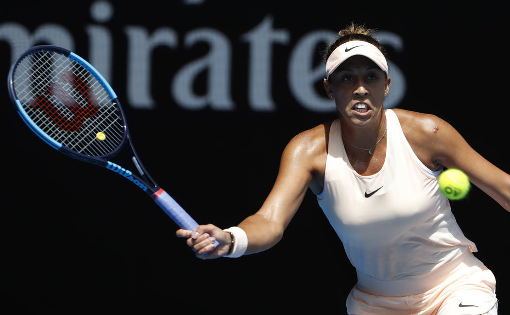 United States' Madison Keys makes a forehand return to Germany's Angelique Kerber during their quarterfinal at the Australian Open tennis championships in Melbourne, Australia, Wednesday, Jan. 24, ...