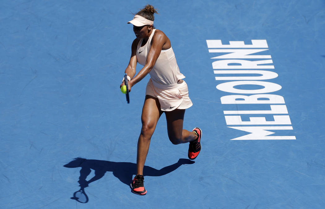United States' Madison Keys makes a backhand return to Germany's Angelique Kerber during their quarterfinal at the Australian Open tennis championships in Melbourne, Australia, Wednesday, Jan. 24, ...