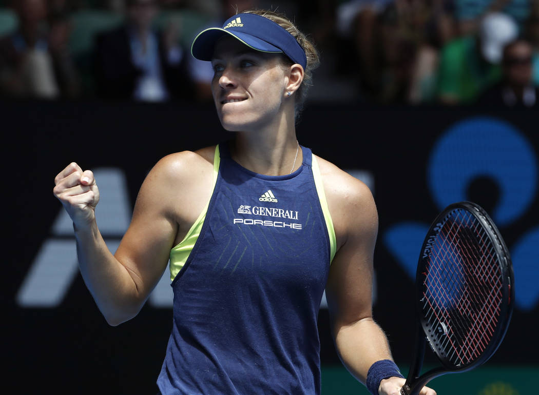 Germany's Angelique Kerber celebrates after defeating United States' Madison Keys in their quarterfinal at the Australian Open tennis championships in Melbourne, Australia, Wednesday, Jan. 24, 201 ...