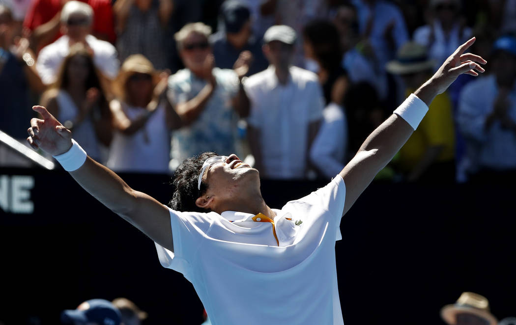 South Korea's Chung Hyeon celebrates after defeating United States' Tennys Sandgren in their quarterfinal at the Australian Open tennis championships in Melbourne, Australia, Wednesday, Jan. 24, 2 ...