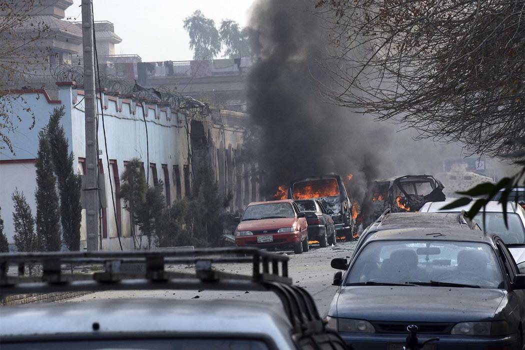 Vehicles burn after a deadly attack in Jalalabad, east of Kabul, Afghanistan, Wednesday, Jan. 24, 2018. Attahullah Khogyani, spokesman for the provincial governor said a group of gunmen stormed th ...