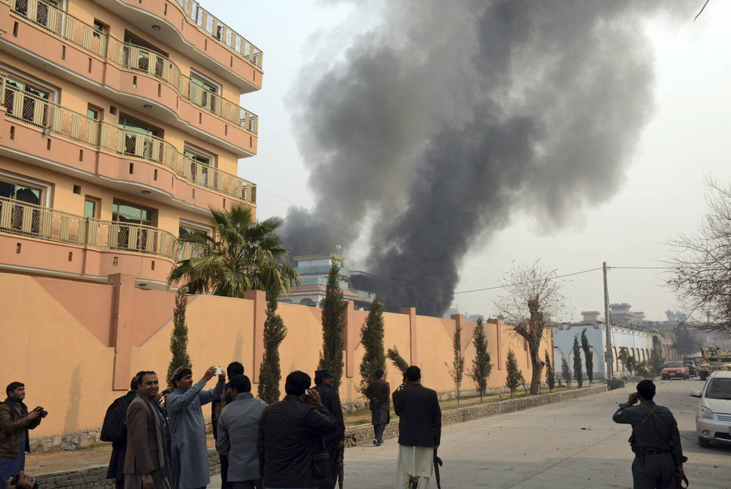 Smokes rises after a deadly suicide attack in Jalalabad, east of Kabul, Afghanistan, Wednesday, Jan. 24, 2018. (AP)