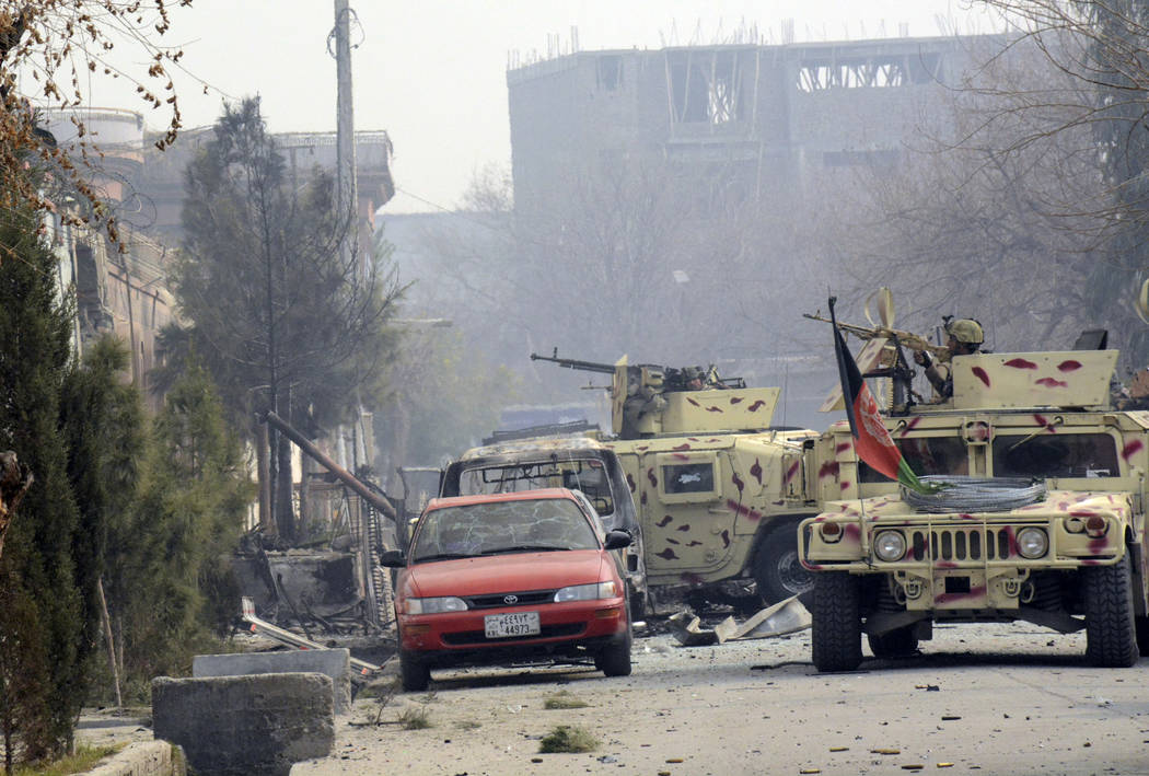 Afghan security personnel arrive after a deadly suicide attack in Jalalabad, east of Kabul, Afghanistan, Wednesday, Jan. 24, 2018. Attahullah Khogyani, spokesman for the provincial governor said a ...