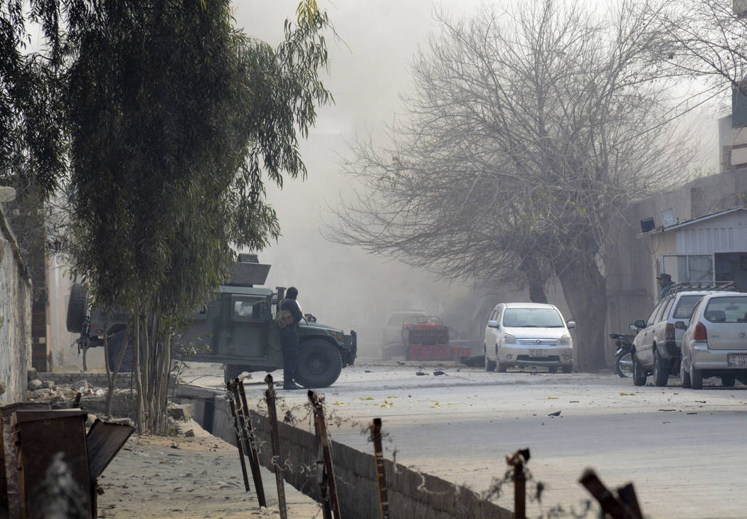 Afghan security personnel stand guard at the scene of a deadly suicide attack in Jalalabad, east of Kabul, Afghanistan, Wednesday, Jan. 24, 2018. Attahullah Khogyani, spokesman for the provincial  ...