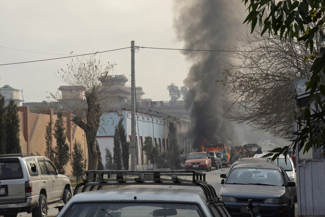 Vehicles burn after a deadly suicide attack in Jalalabad, east of Kabul, Afghanistan, Wednesday, Jan. 24, 2018. Attahullah Khogyani, spokesman for the provincial governor said a group of gunmen st ...
