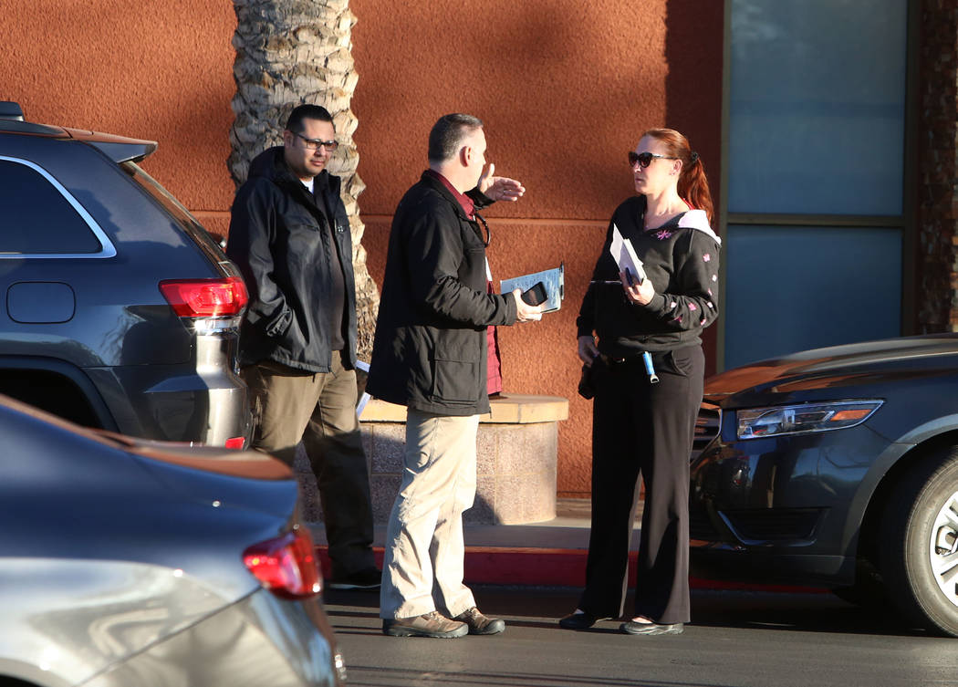 Las Vegas police detectives gathered outside the Best Buy at 6950 Arroyo Crossing, near the 215 Beltway and Rainbow Boulevard Tuesday, Jan. 23, 2018, where a man was kidnapped and carjacked in fro ...