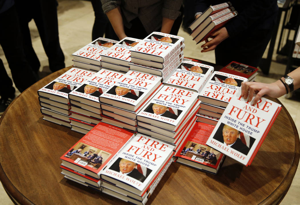 """In this Tuesday, Jan. 9, 2018, file photo, copies of Michael Wolff's """"Fire and Fury: Inside the Trump White House"""" are on display as they go on sale at a bookshop, in London. (Alastair Grant, AP)"""