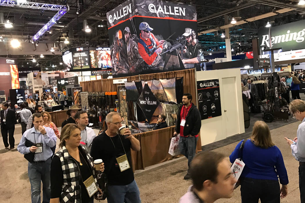 Attendees wander miles of aisles at the 2017 Shooting Hunting and Outdoor Trade (SHOT) Show in Las Vegas. This is the trade show where manufacturers and vendors meet to decide what customers will  ...