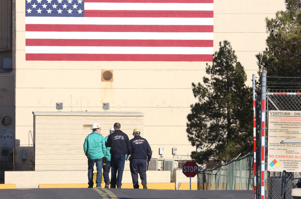 Investigaters from Clark County Fire, Henderson Fire and workers from the TIMET plant arrive at the scene of an explosion involving magnesium used in the manufacturing process at the plant on Wedn ...