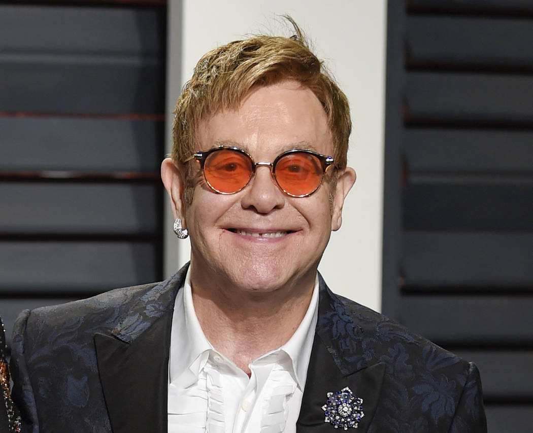 Elton John arrives at the Vanity Fair Oscar Party in Beverly Hills, California, Feb. 27, 2017.  Elton John announced Wednesday, Jan. 24, 2018 that his upcoming tour will be his last. (Evan Agostin ...