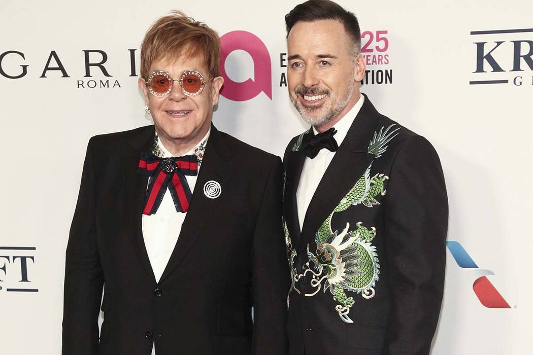Elton John, left, and David Furnish attend the Elton John AIDS Foundation's 25th Anniversary Gala at The Cathedral of St. John the Divine on Tuesday, Nov. 7, 2017, in New York. (Andy Kropa/Invisio ...