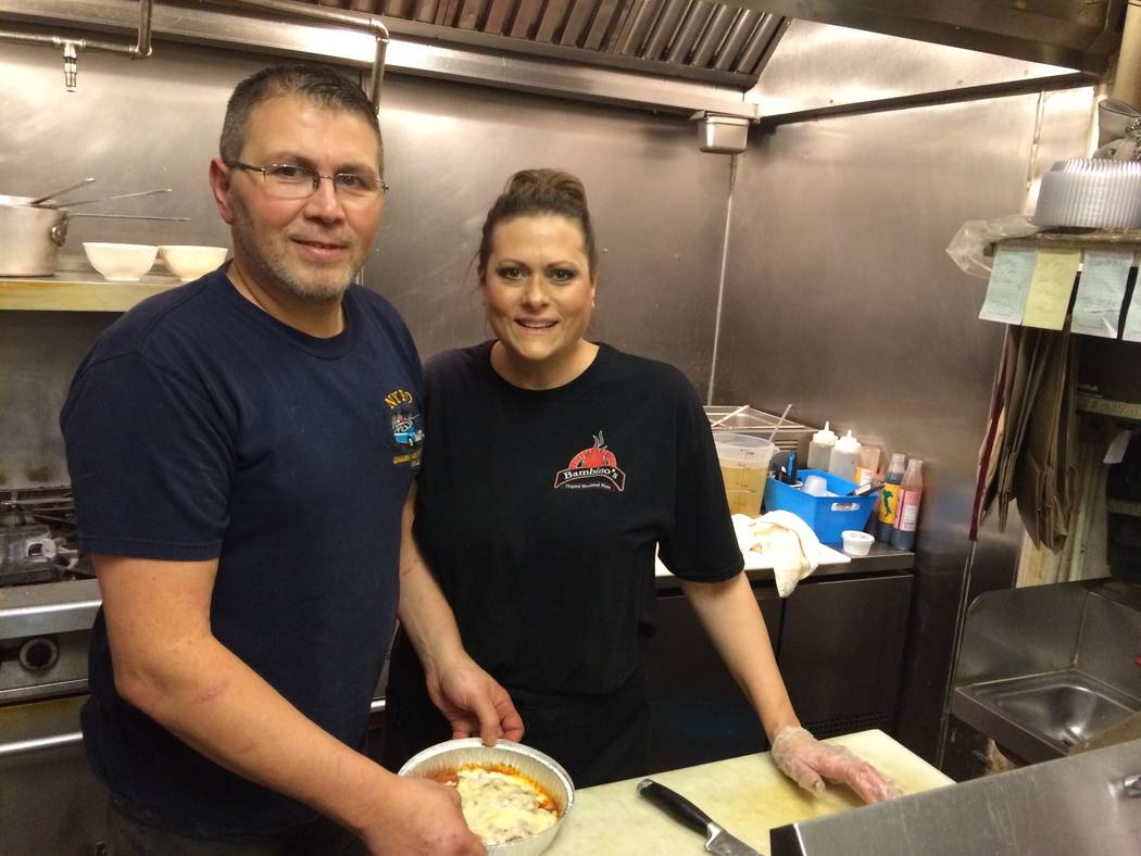 Ralph and Anna Marie Pota pause while making pizzas in this photo from December 2016. The couple met when both lived in the New York City area and Anna Marie was smitten from the moment she laid e ...