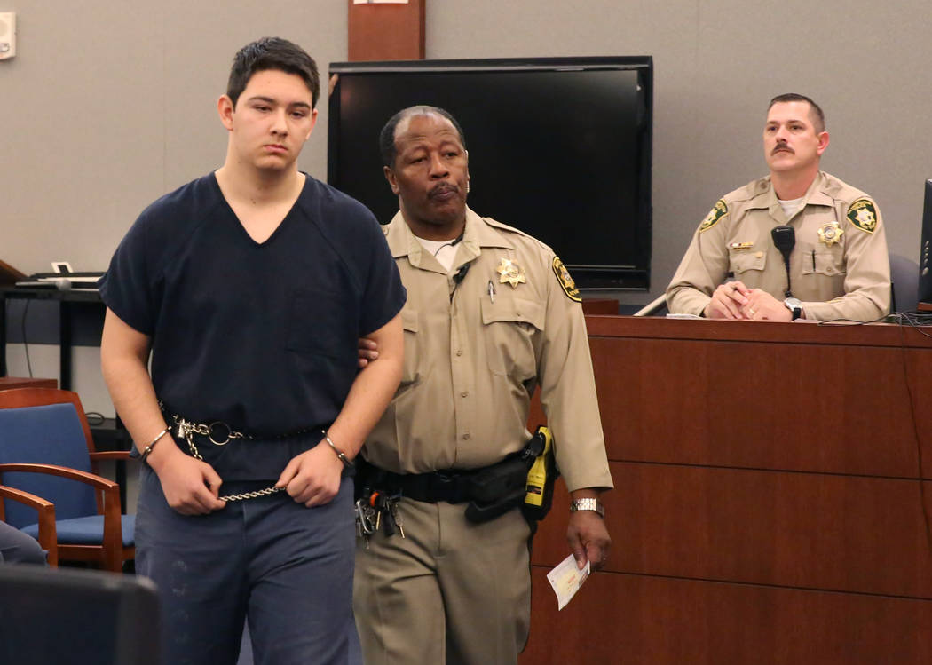 Maysen Melton, a 16-year-old boy accused of raping classmates, lead out of the courtroom after his bail hearing at the Regional Justice Center on Thursday, Jan. 25, 2018, in Las Vegas. (Bizuayehu  ...