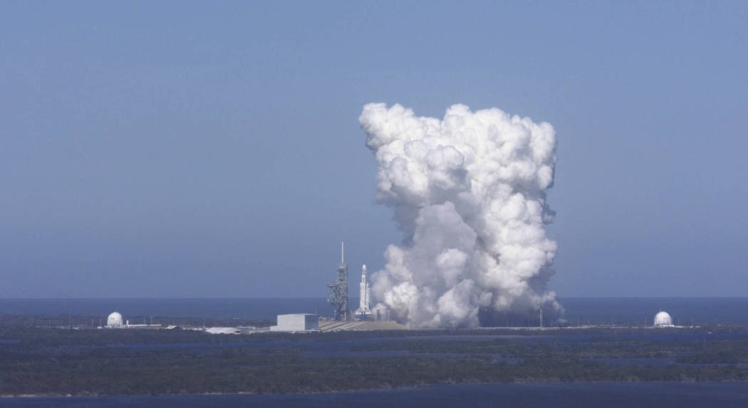 In this image from video made available by SpaceX, a Falcon Heavy rocket is test fired at Cape Canaveral, Fla., on Wednesday, Jan. 24, 2018. The rocket's three boosters — 27 engines in all  ...