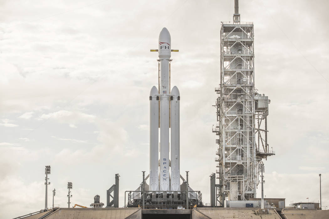 This Dec. 28, 2017 photo made available by SpaceX shows a Falcon Heavy rocket at Cape Canaveral, Fla. On Wednesday, Jan. 24, 2018, the rocket's three boosters — 27 engines in all — w ...