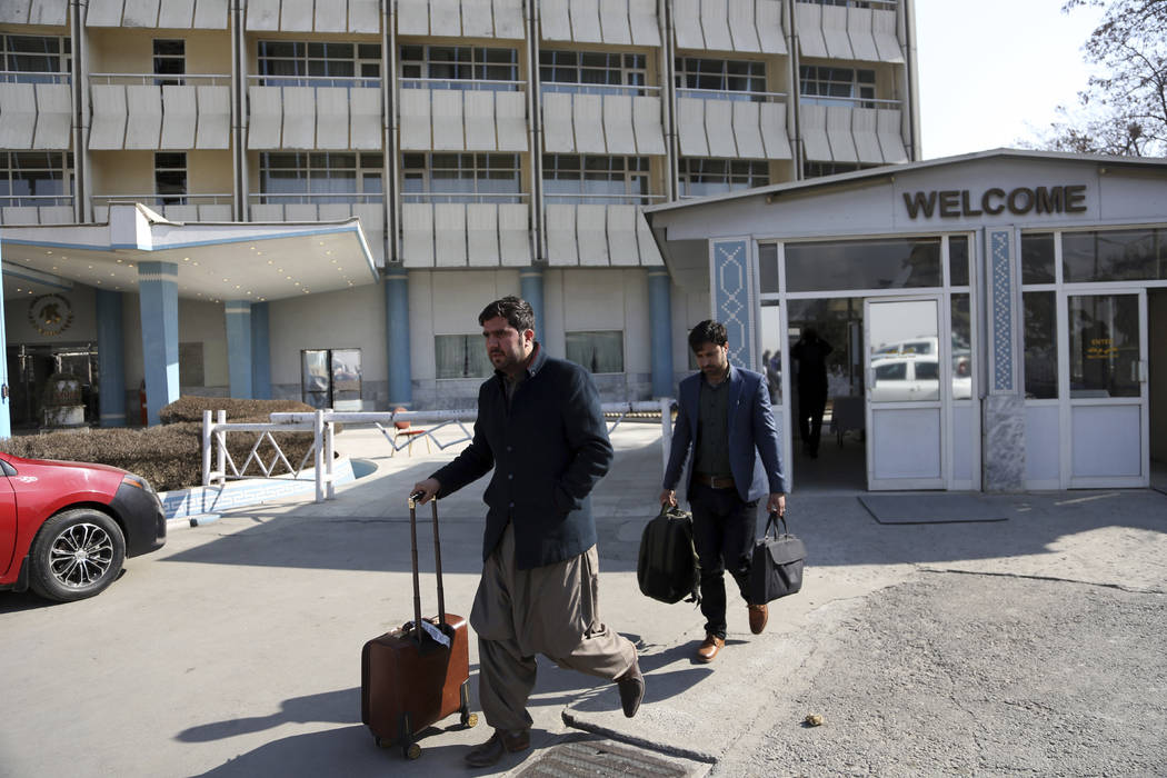 Guests of the hotel collect their luggage two days after the end of the siege from the Intercontinental Hotel after a deadly attack in Kabul, Afghanistan, Tuesday, Jan. 23, 2018. Survivors of the  ...