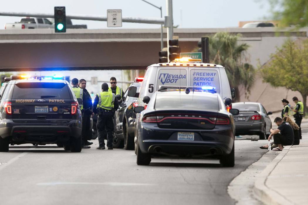 The Nevada Highway Patrol investigates a fatal crash on Boulder Highway at the entrance to U.S. Highway 95 on Monday, Aug. 21, 2017. (Bizuayehu Tesfaye/Las Vegas Review-Journal) @bizutesfaye
