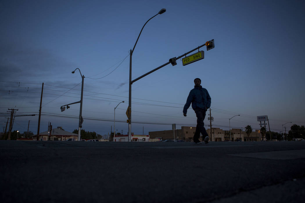 A pedestrian uses the crosswalk at the intersection of Whitney Avenue and Boulder Highway in Las Vegas on Wednesday, Jan. 24, 2018. The Nevada Department of Transportation plans to spend $2 millio ...