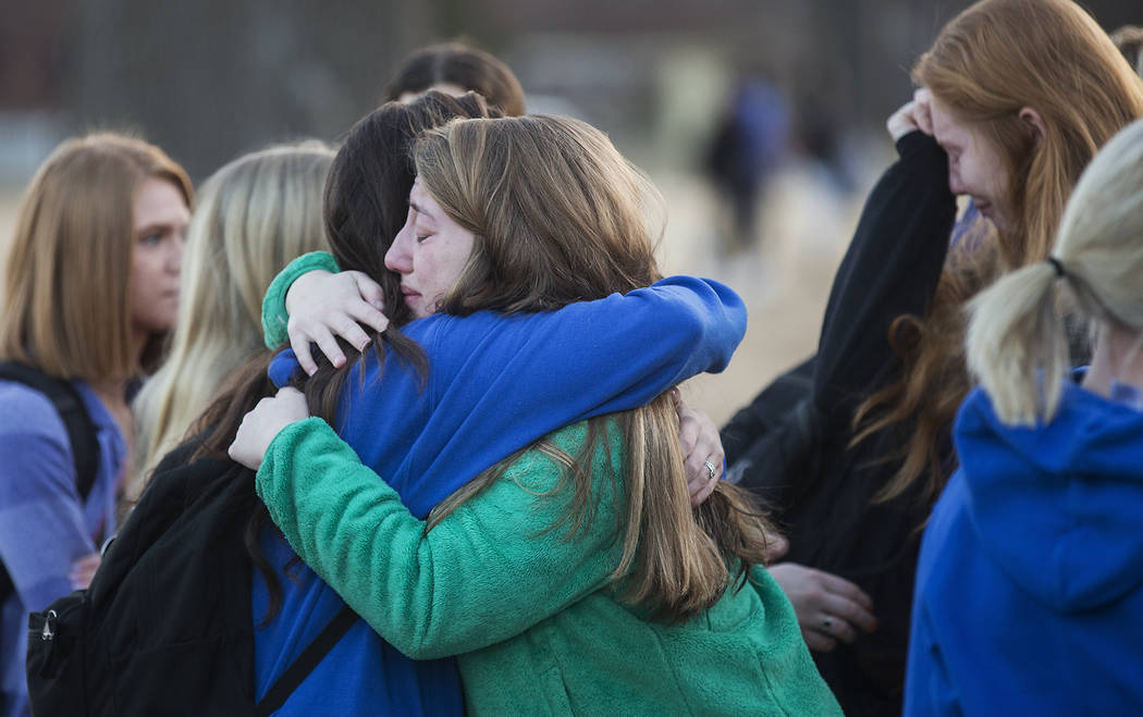 Students embrace following a prayer vigil at Paducah Tilghman High School in Paducah, Ky., Wednesday, Jan. 24, 2018, in Paducah, Ky. The gathering was held for the victims of the Marshall County H ...