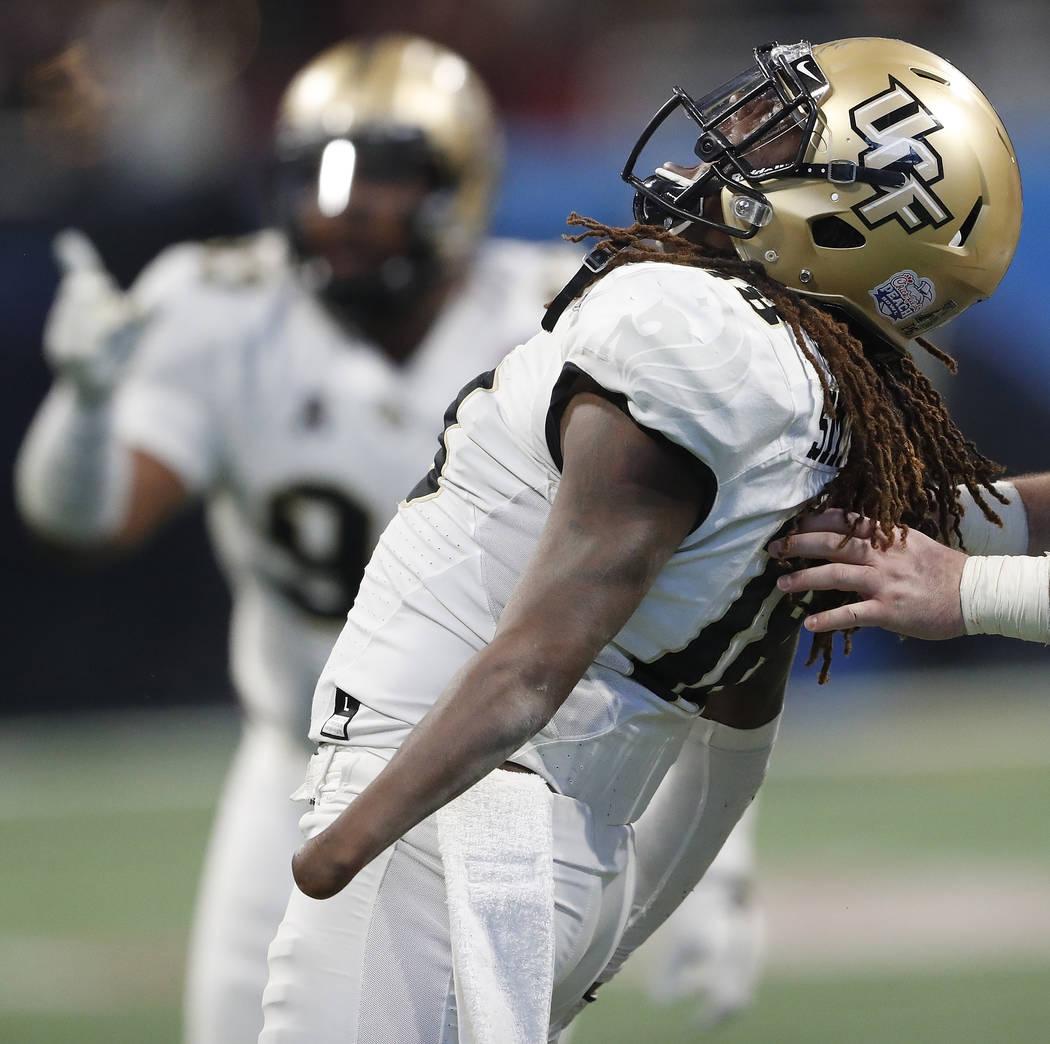 Central Florida linebacker Shaquem Griffin (18) celebrates a sack on Auburn quarterback Jarrett Stidham (8) during the second half of the Peach Bowl NCAA college football game, Monday, Jan. 1, 201 ...